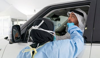 Abu Dhabi's Crown Prince Sheikh Mohammed bin Zayed al-Nahyan is tested for COVID-19 at a mobile test center in Abu Dhabi, UAE. March 28, 2020