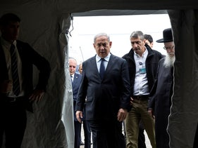 Netanyahu enters a tent during his visit to Sheba Medical Center at Tel Hashomer in Ramat Gan, February 19, 2020.
