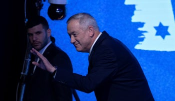 Benny Gantz waves to supporters at an election night rally in Tel Aviv, March 3, 2020.