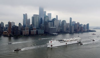 The USNS Comfort passes Manhattan as it enters New York Harbor during the outbreak of the coronavirus disease (COVID-19) in New York City, U.S., March 30, 2020.