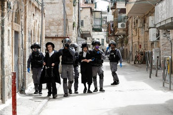 Israeli police detain ultra-Orthodox Jewish men during scuffles as police enforce a partial lockdown against coronavirus in Jerusalem. March 30, 2020