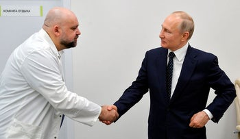 FILE In this file photo taken on Monday, March 23, 2020, Russian President Vladimir Putin, right shakes hands with the hospital's chief Denis Protsenko during his visit to the hospital for coronavirus patients in Kommunarka, outside Moscow, Russia