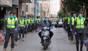 Volunteers from Hezbollah's Islamic health unit stand in preparation to sanitize streets as precaution against the spread of coronavirus disease (COVID-19), during a media tour organised by Hezbollah officials in Beirut's southern suburb, Lebanon March 31, 2020