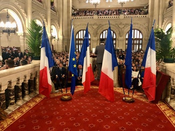 French President Emmanuel Macron and other dignitaries at the Grand Synagogue of Paris.