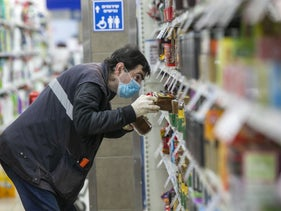 An Israeli scans supermarket shelves amid the coronavirus pandemic.
