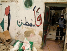 Sanitizing a house in al-Fari'ah refugee camp, part of a coronavirus prevention campaign by UNRWA and the Popular Committee. March 31, 2020