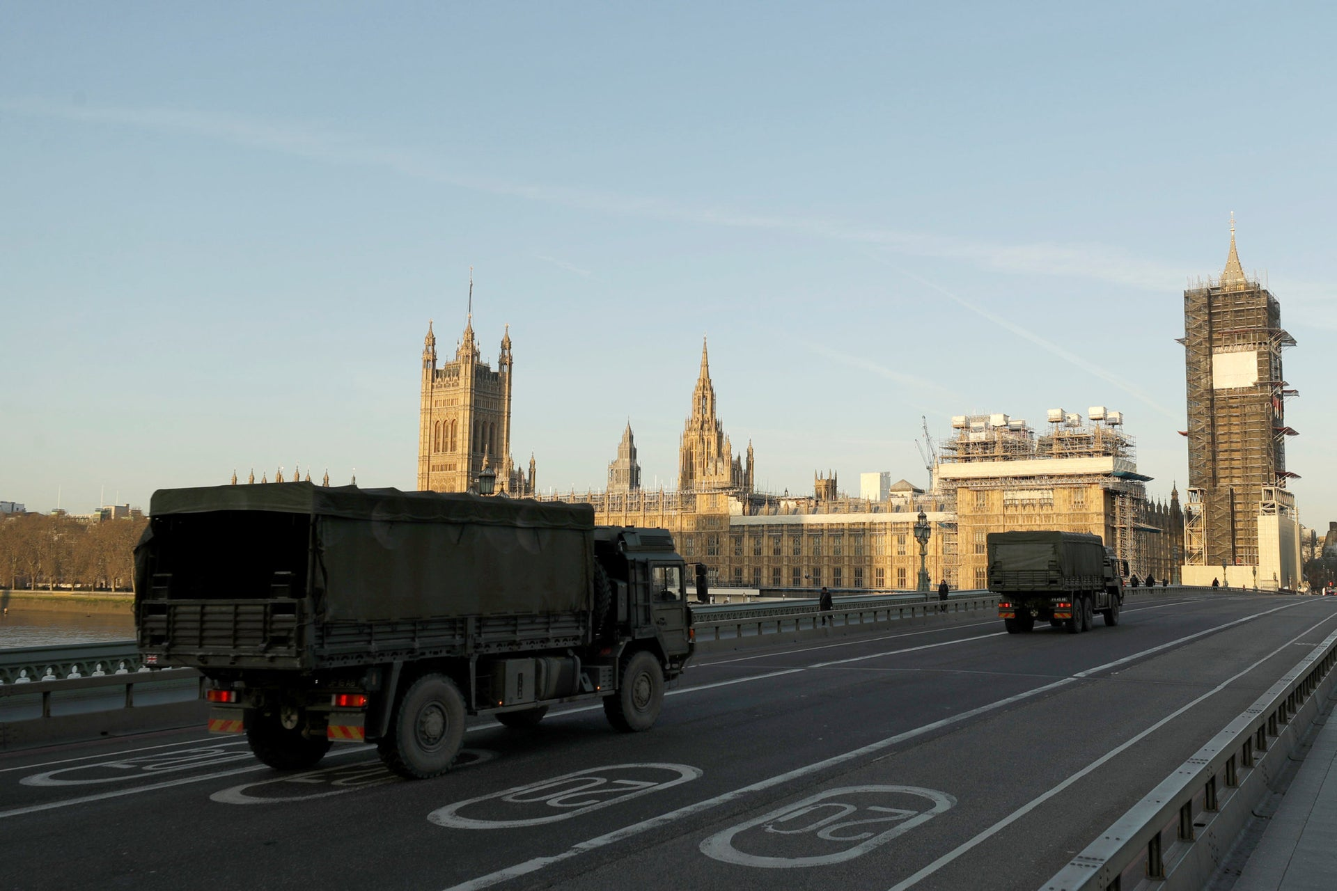 British Army trucks cross Westminster Bridge towards the Houses of Parliament in London, March 24, 2020.
