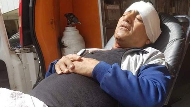 Naji Tantara being taken to hospital after being attacked with an ax in the village of Umm Safa in the West Bank, March 24, 2020.