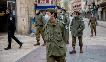 Soldiers and police wearing masks in central Jerusalem on April 1, 2020.