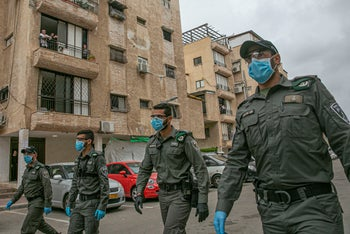 Border Police officers wearing protective face masks as they enter the largely ultra-Orthodox city of Bnei Brak as Israel battles to contain the coronavirus, April 3, 2020.