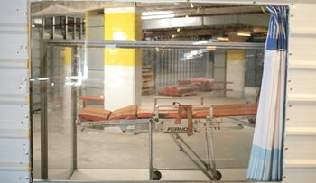 A plexiglass case at Sheba Medical Center that enables relatives to part with deceased patients, April 2020.