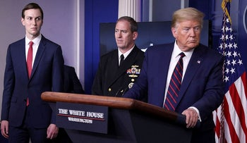 White House senior adviser Jared Kushner looks on with Navy Rear Admiral John Polowczyk, supply chain task force lead for FEMA, as U.S. President Donald Trump leads the daily coronavirus response briefing at the White House in Washington, U.S., April 2, 2020