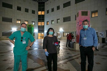 Staff outside the coronavirus ward of Sheba Medical Center, Tel Hashomer.