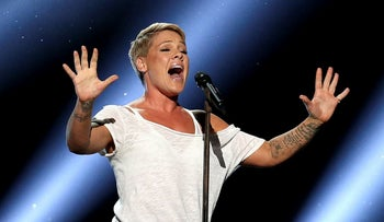 """In this Jan. 28, 2018, file photo, Pink performs """"Wild Hearts Can't Be Broken"""" at the 60th annual Grammy Awards at Madison Square Garden in New York"""