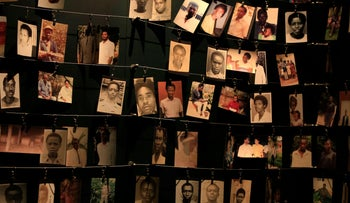 Photographs of people who were killed during the 1994 genocide are seen inside the Kigali Genocide Memorial Museum in the Rwandan capital Kigali, April 5, 2014.