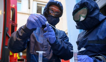 French firefighters wearing protective equipment trying to detect the presence of SARS-CoV-2 in the environment in Marseille, April 3, 2020.