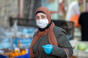 A woman shopping while wearing a mask, Jerusalem, April 2020.