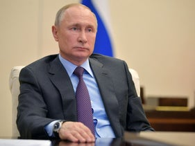 Russian President Vladimir Putin attends a meeting on global energy markets via a video link at his residence outside Moscow, Russia April 3, 2020