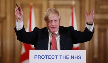 British Prime Minister Boris Johnson gestures during his daily COVID 19 coronavirus press briefing, London, March 22, 2020.