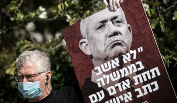 A protester against Gantz's decision to join a Netanyahu-led government, April 2020.