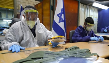 Israeli civilian workers working for the Israeli army manufacture protective masks during the coronavirus pandemic, at the Israeli military base of Tel Hashomer, near Tel Aviv. April 2, 2020
