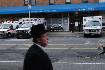 A member of the Orthodox community moving past a special coronavirus intake area at Maimonides Medical Center in the Borough Park neighborhood, April 5, 2020.