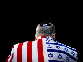 A member of the audience looks on wearing a United States-Israel themed custom suit during the AIPAC convention at the Washington Convention Center in Washington, U.S., March 2, 2020.
