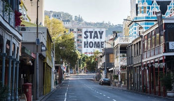 A general view of a deserted Long Street, usually one of the busiest and most popular entertainment areas in Cape Town, with a billboard reading Stay Home, April 3, 2020.