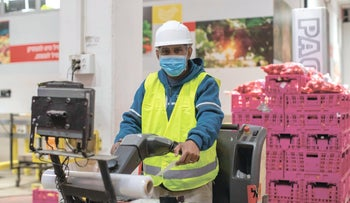 A Rami Levy employee at one of the company's fulfillment centers for online orders, March 29, 2020.
