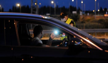 A police checkpoint in Tel Aviv, as Israel enforces a lockdown to curb coronavirus during the Passover holiday, April 7, 2020.