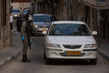An Israeli soldier enforcing movement restrictions in the ultra-Orthodox neighborhood of Mea Shearim, Jerusalem, April 6, 2020.