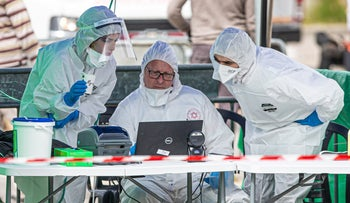 Paramedics in a coronavirus testing center in Bnei Brak, April 1, 2020.