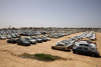 Cars confiscated from people who violated a curfew amid concerns over the spread of the coronavirus disease (COVID-19), are seen in a car park outside Amman, Jordan, April 7, 2020.