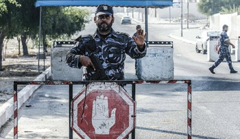 A Hamas security officer unrelated to the story mans a checkpoint in Khan Yunis in the southern Gaza Strip on August 28, 2019.
