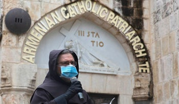 Franciscan friars retrace the Via Dolorosa in Jerusalem's Old City on Friday after the traditional mass procession was called off amid coronavirus fears in Jerusalem, Friday, April 10, 2020
