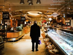 A man pauses in a empty market in Grand Central Terminal stands as the coronavirus epidemic keeps people inside on April 10, 2020 in New York City.
