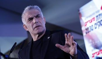 Yair Lapid speaks at a conference in Herzliya, February 26, 2020.