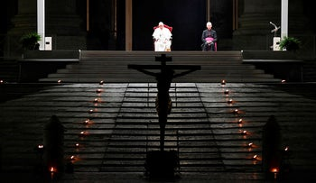 A photo taken and handout on April 10, 2020 by the Vatican Media shows Pope Francis presiding over Good Friday's Way of the Cross (Via Crucis) at St. Peter's Square in The Vatican on April 10, 2020