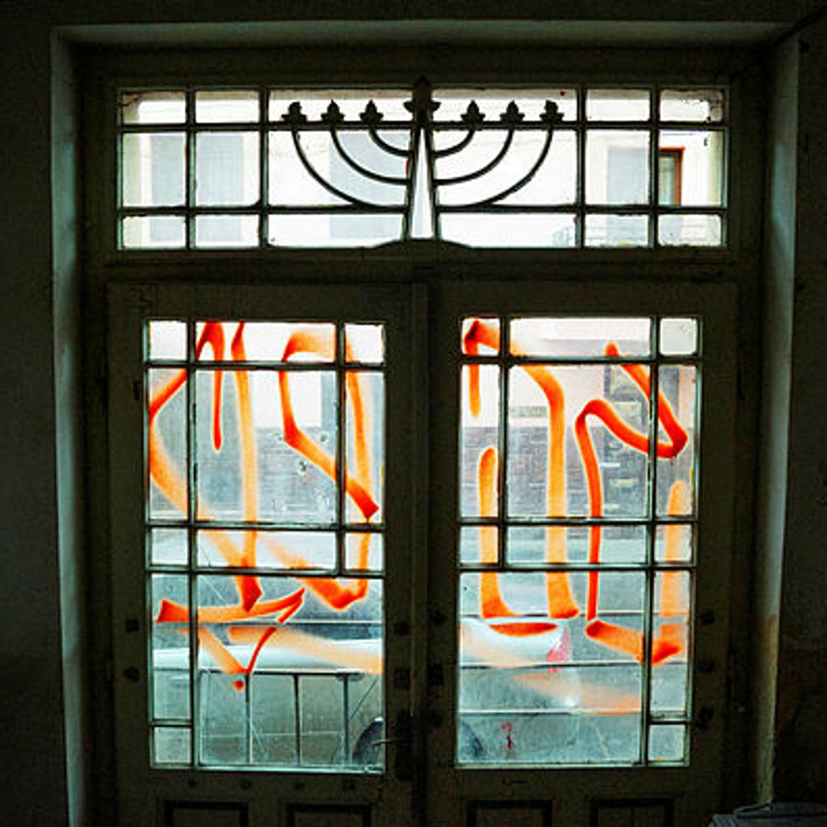 The defaced entrance of a former Jewish school in Sibiu, Romania.