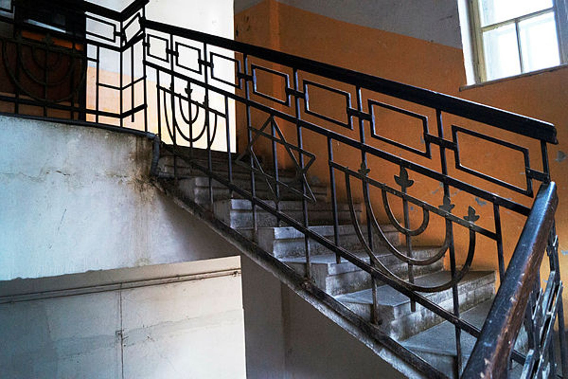 Menora and star of David motifs decorate the stairway of a former Jewish school in Sibiu, Romania.