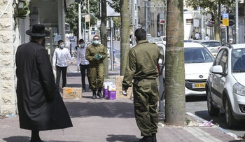 Israeli army soldiers deployed in the largely ultra-Orthodox city of Bnei Brak, which became a coronavirus hot spot, April 2020.
