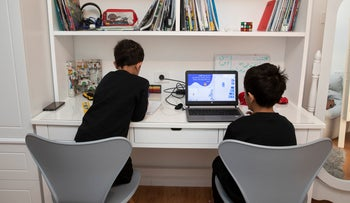 Elementary school students study online as Israel shutters schools to contain the spread of the coronavirus, Kafr Qasem, Israel, March 2020.