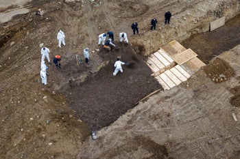 Bodies being buried on New York's Hart Island where the department of corrections is dealing with more burials overall, amid the coronavirus outbreak in New York City, April 9, 2020.