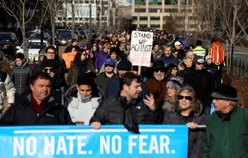 People march in solidarity from Foley Square over the Brooklyn Bridge, concluding their rally against anti-Semitism at Cadman Plaza, Sunday, Dec. 5, 2020, in the Brooklyn borough of New York.