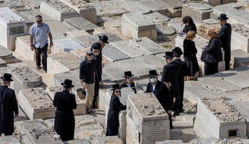 A funeral of a man who died of COVID-19, Mount of Olives, Jerusalem, March 2020.