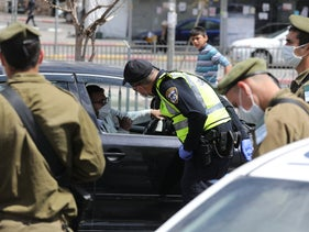Israeli army and police forces inspect drivers in Jerusalem, April 8, 2020.