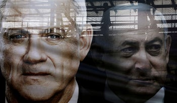 A banner depicts Benny Gantz, leader of Blue and White party, and Benjamin Netanyahu, ahead of the last election, in Tel Aviv, Israel February 17, 2020.
