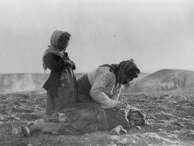 An Armenian refugee from genocide in Syria mourns her dead child. Photo taken by the aid organization Near East Relief (for Armenian refugees)