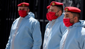 Members of Palestinian Hamas security forces wear protective gear as precaution against the coronavirus disease, at Rafah border crossing in the southern Gaza Strip, on April 13, 2020.
