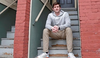 Cameron Karosis, 27, a software salesman, poses for a portrait outside his home, Tuesday, April 14, 2020, in Cambridge, Mass